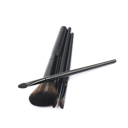 aseo personal: Pile of a few makeup tools isolated over the white background