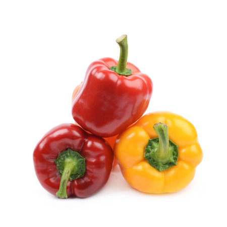 Pile of bright and colorful ripe peppers isolated over the white background Stock Photo