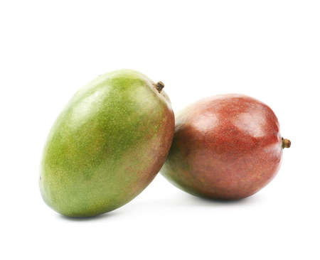 Two ripe mango fruits isolated over the white background Stock Photo