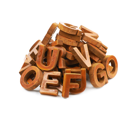 Pile of painted block wooden letters isolated over the white background
