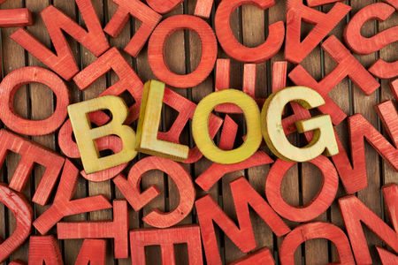 blogosphere: Word Blog made of green wooden block letters over the pile of red ones