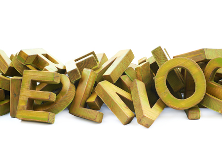 Pile of painted block wooden letters isolated over the white background, close-up crop framgent composition Stock Photo