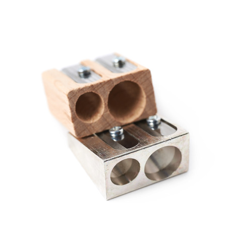 sharpeners: Two, metal and wooden pencil sharpeners, composition isolated over the white background