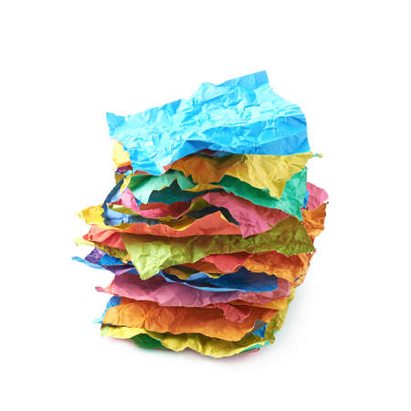 Pile of crumpled colorful origami paper sheets isolated over the white background