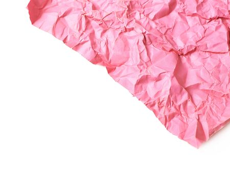 Fragment of a crumpled origami paper sheet isolated over the white background, close-up crop composition as a copyspace backdrop with a shallow depth of field Stock Photo