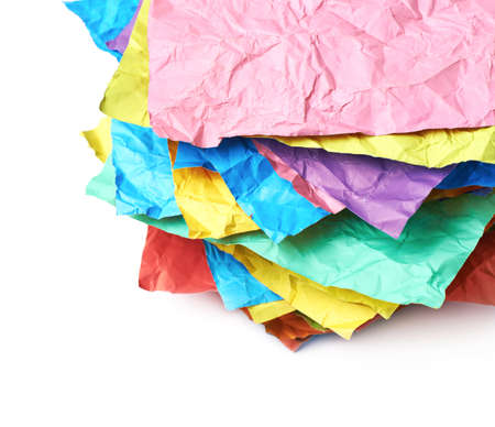 Pile of crumpled colorful origami paper sheets isolated over the white background, close-up crop composition