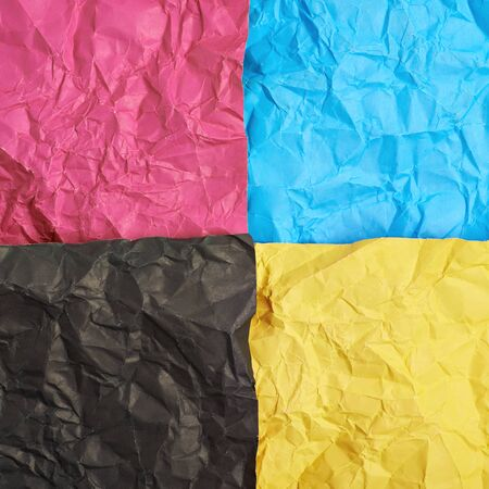 cmyk abstract: Four CMYK colored crumpled origami paper sheets as an abstract backdrop composition