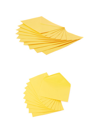 sobres para carta: Stack of multiple yellow letter envelopes isolated over the white background, set of two different foreshortenings Foto de archivo