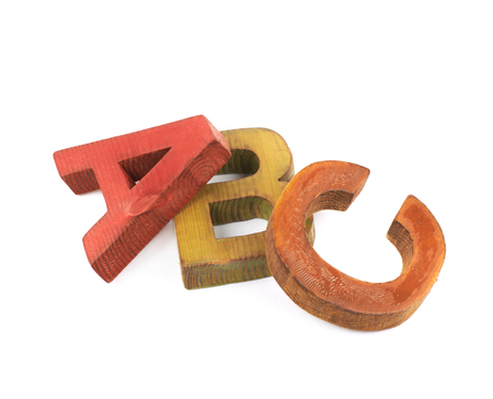 ABC composition made of colored wooden letters isolated over the white background Stock Photo