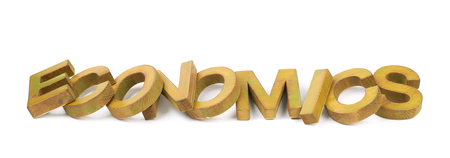 economic theory: Word Economics made of colored with paint wooden letters, composition isolated over the white background Stock Photo