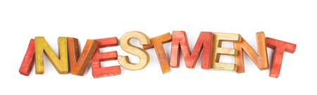Word Investment made of colored with paint wooden letters, composition isolated over the white background