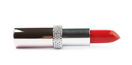 Tube of red lipstick lying on its side, isolated over the white background Stock Photo