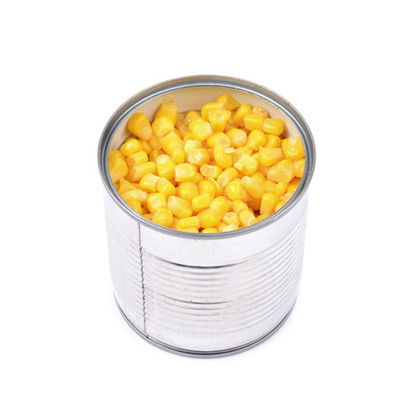tinned goods: Canned corn in an opened tincan isolated over the white background Stock Photo