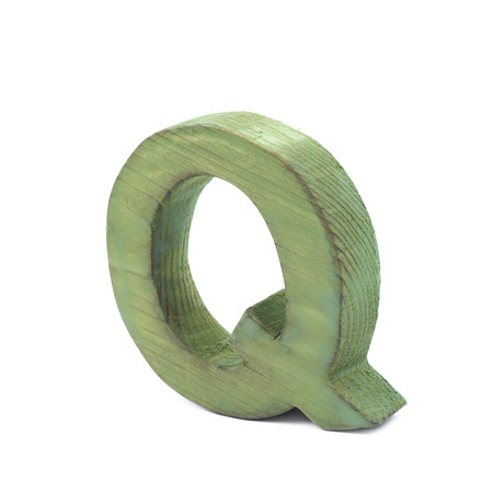 sawn: Single sawn wooden letter Q symbol coated with paint isolated over the white background Stock Photo