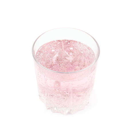 carbonated: Rocks old fashioned glass filled with the carbonated pink lemonade water isolated over the white background