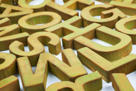 Surface coated with the multiple painted wooden block letters as an abstract backrop composition Stock Photo