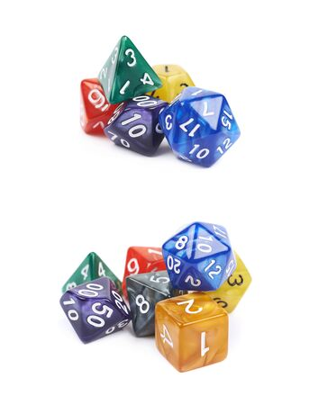 Pile of colorful roleplaying polyhedral dices isolated over the white background, set of two different foreshortenings