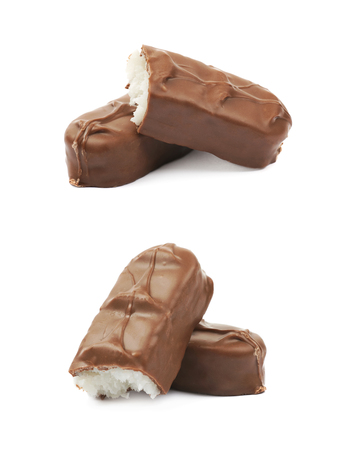 Composition of two coconut filled chocolate bars isolated over the white background, set of two different foreshortenings