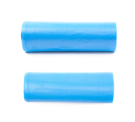 degradable: Blue plastic polyethylene trash bag roll isolated over the white background, set of two different foreshortenings Stock Photo
