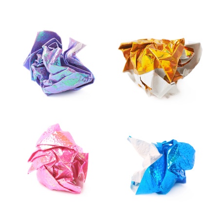 Crumbled ball of colorful origami paper sheet isolated over the white background, set of four different foreshortenings