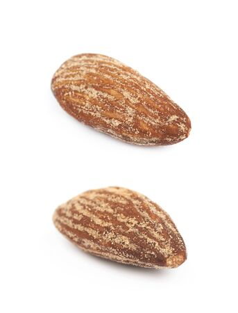 Almond nut coated with spicy powder isolated over the white background, set of two different foreshortenings