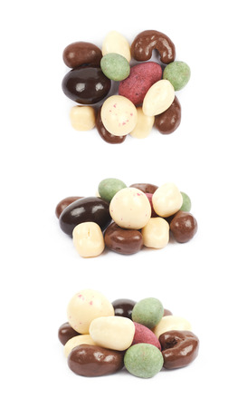 differently: Pile of multiple differently glazed chocolate nuts isolated over the white background, set of three different foreshortenings