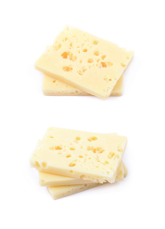 Pile of cheese slices isolated over the white background, set of two different foreshortenings Stock Photo