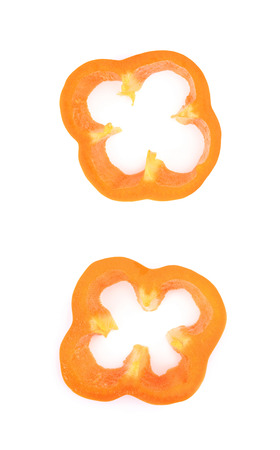 pimiento: Slice of an orange bell pepper isolated over the white background, set of two different foreshortenings Stock Photo