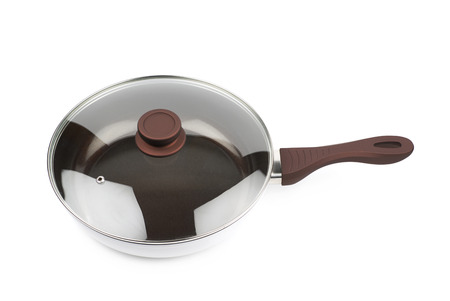 teflon: Brand new brown frying pan with a teflon coating and a glass lid over it, composition isolated over the white background