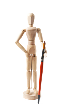 Wooden human statuette holding a drawing brush, composition isolated over the white background Stock Photo