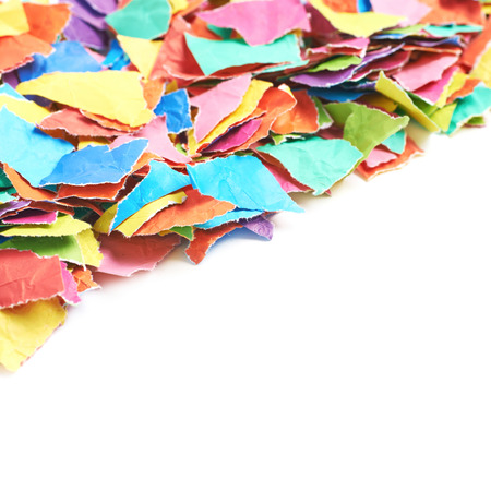 Pile of multiple colorful torn paper pieces isolated over the white background, close-up crop composition with a shallow depth of field Stock Photo