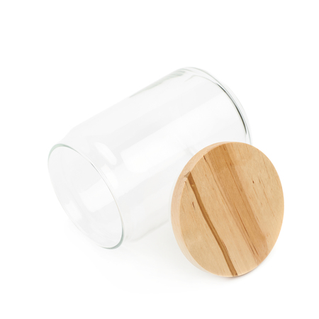 airtight: Empty glass kitchen jar with a round wooden cap, composition isolated over the white background