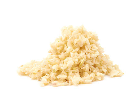 Pile of minced garlic isolated over the white background Stock Photo