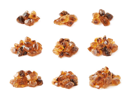 rock pile: Pile of brown rock sugar crystals isolated over the white background, set of nine different foreshortenings