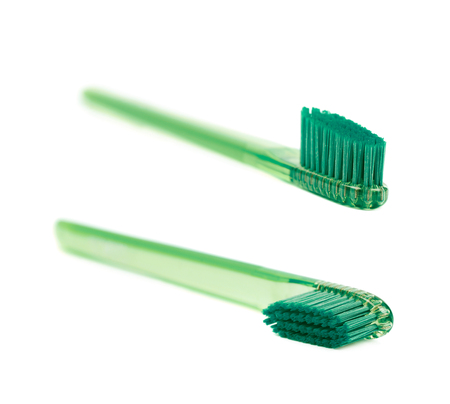 Plastic green toothbrush isolated over the white background, set of two different foreshortenings Stock Photo