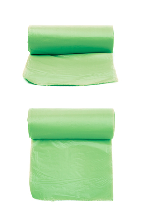 degradable: Green plastic polyethylene trash bag roll isolated over the white background, set of two different foreshortenings Stock Photo