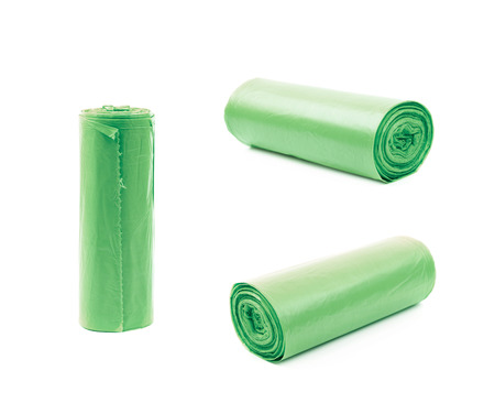 degradable: Green plastic polyethylene trash bag roll isolated over the white background, set of three different foreshortenings