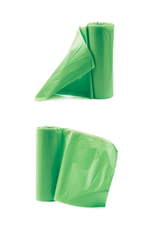 Green plastic polyethylene trash bag roll isolated over the white background, set of two different foreshortenings Stock Photo