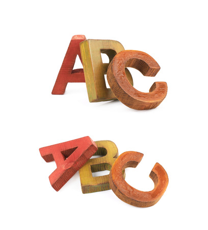 ABC composition made of colored wooden letters isolated over the white background, set of two different foreshortenings