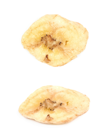 Baked and dried banana chip slice isolated over the white background, set of two different foreshortenings Stock Photo