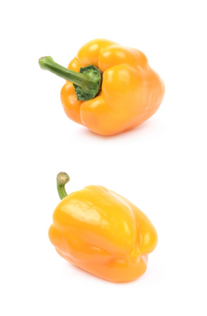 Ripe yellow bell pepper isolated over the white background, set of two different foreshortenings Stock Photo