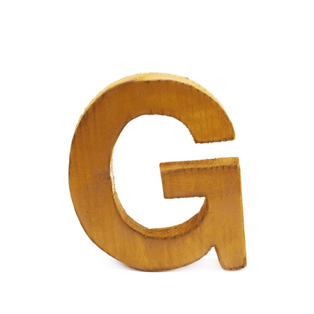 sawn: Single sawn wooden letter G symbol coated with paint isolated over the white background Stock Photo