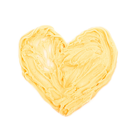 Heart shape made of frosting cream isolated over the white background Stock Photo