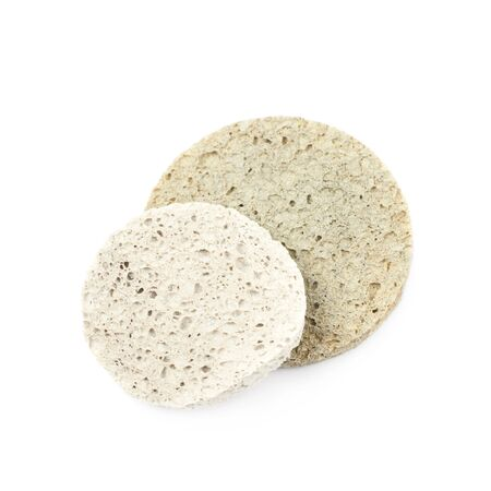 Two used make-up cleaning round sponges, composition isolated over the white background