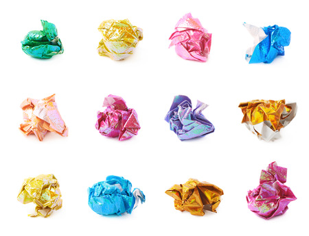 Crumbled ball of colorful paper isolated
