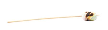 marshmellow: Single marshmallow candy on a stick