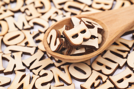 Surface covered with wooden letters Stock Photo