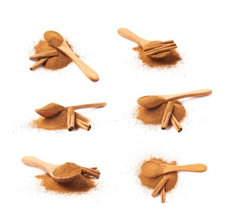 Pile of cinnamon powder isolated Stock Photo