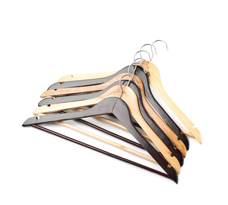 clothe: Pile of wooden hangers isolated Stock Photo