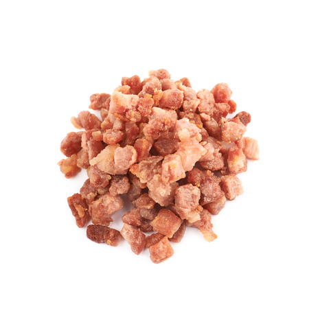 pancetta cubetti: Pile of fried bacon bits isolated